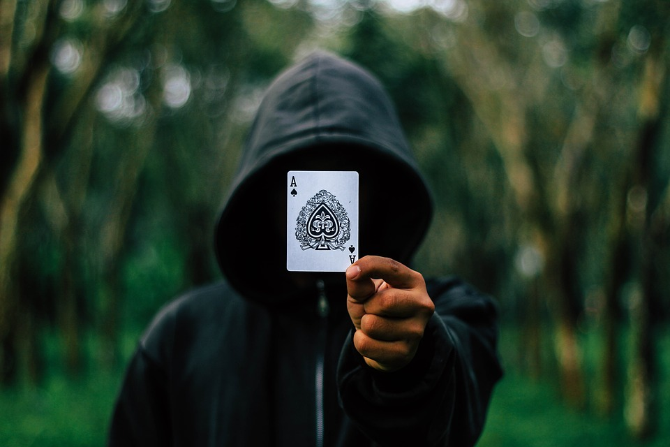 Hooded Man with Ace